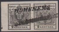Österreich 1850, Nr. 2 H I a, 2 Kreuzer schwarz, Handpapier Type I a im waagrechten Paar links mit 5 mm Bogenrand, entwertet mit seltenem einzeiligem Langstempel HOHENEMS, ATTEST Goller